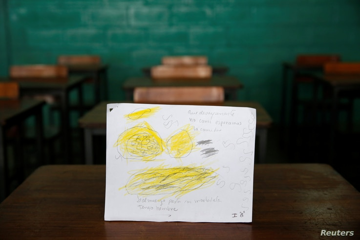 A drawing made during a lesson at a school shows what a student ate during the course of a day in Caracas, Venezuela, July 14, 2016.