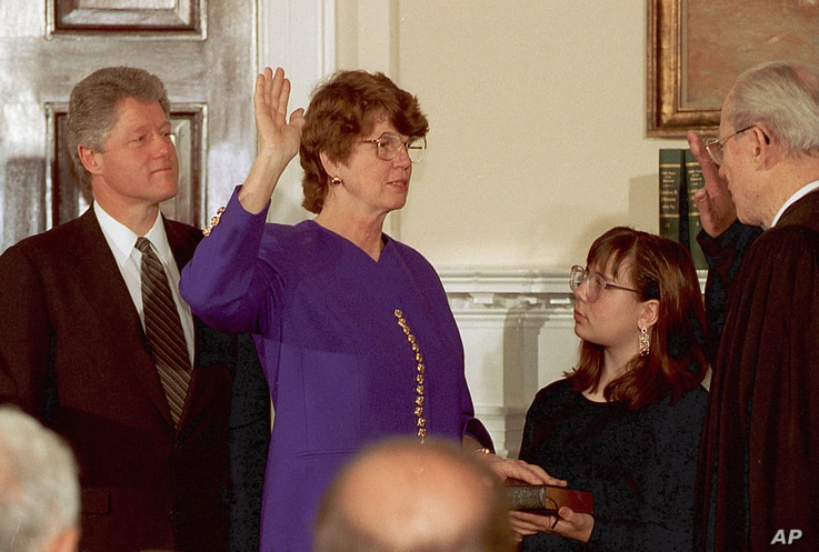 FILE - Supreme Court Justice Byron White, right, administers the oath of office to Janet Reno making her Attorney General during a ceremony at the White House, March 12, 1993.