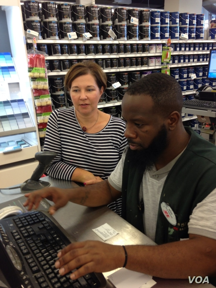 Gina Schaefer talks with employee Brian Cole.