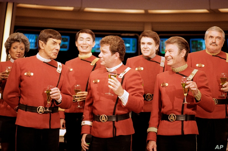 """Members of the """"Star Trek"""" crew, from right in front: DeForest Kelley, William Shatner and Leonard Nimoy, and back row from right: James Doohan, Walter Koenig, George Takei and Nichelle Nichols, toast """"Star Trek V: The Final Frontier,"""" during a news ..."""