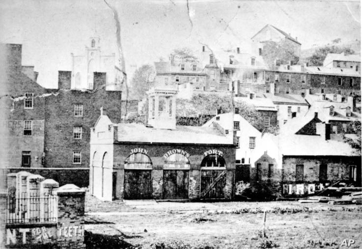 FILE- An undated photo of John Brown's Fort shows the entrance of the Armory Grounds at Harpers Ferry, West Virginia. Brown and his followers used the fire engine and guard house as their fort when they raided the U.S. armory and arsenal on Oct. 16, ...