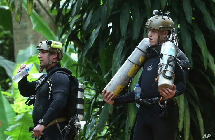 International rescuers prepare to enter the cave where a young soccer team and their coach are trapped by floodwaters, July 5, 2018, in Mae Sai, Chiang Rai province, in northern Thailand.