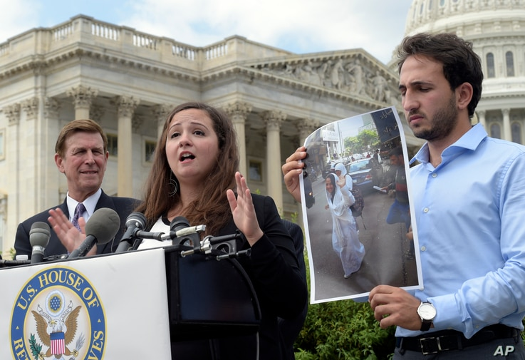 FILE - Alaa Hijazi, center, speaks about her sister Aya Hijazi, in photograph, during a news conference on Capitol Hill in Washington, Sept. 15, 2016.