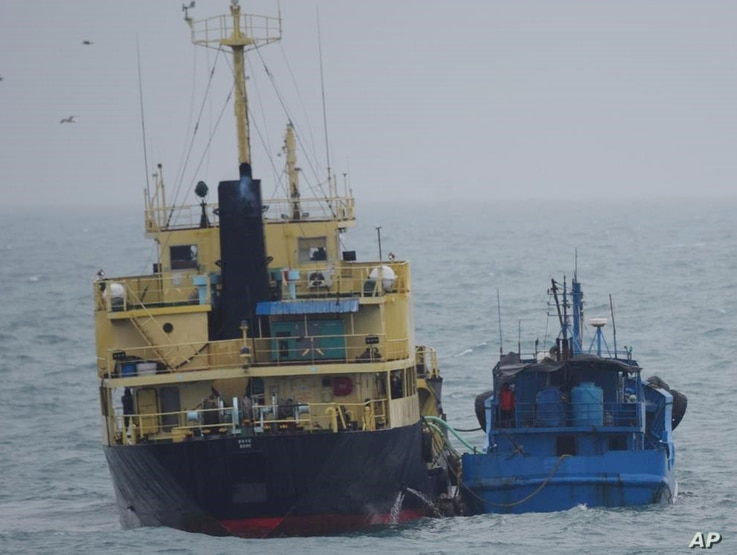 "FILE - This photo released by Japan's Ministry of Defense shows what it says is the North Korean-flagged tanker Yu Jong 2, left, and the Min Ning De You 078 lying alongside in the East China Sea, Feb. 16, 2018. China said it was ""highly concerned"" ab..."