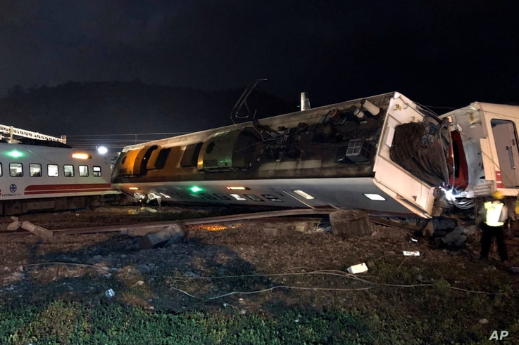 In this photo released by Taiwan Railways Administration, train carriages are scattered at the site of a train derailment in Yilan county northeastern Taiwan on Sunday, Oct. 21, 2018.
