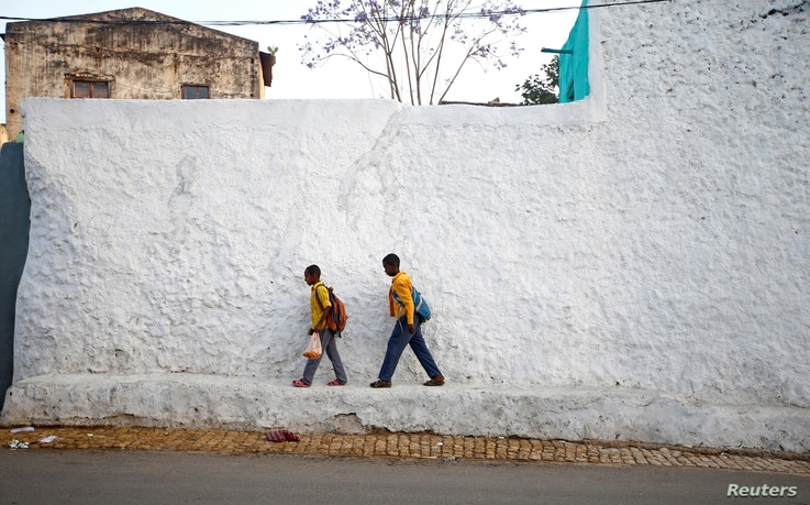 Students walk within the walled city of Harar, Ethiopia, Feb. 24, 2017.