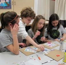 Pennsylvania students create quilt patches bearing their pledges to save the environment.