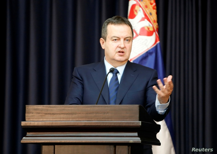 Serbian Foreign Minister Ivica Dacic gestures during a news conference in the West Bank town of Bethlehem Jan. 6, 2017.