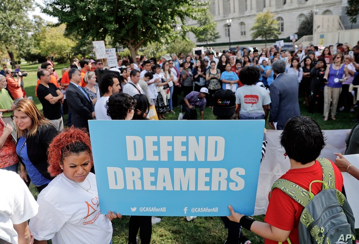 Immigrant rights supporters gather at the U.S. Capitol in Washington, Sept. 26, 2017.