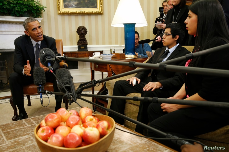 """FILE - US President Barack Obama meets with a group of """"dreamers"""" who have received Deferred Action for Childhood Arrivals (DACA) at the White House in Washington, Feb. 4, 2015."""