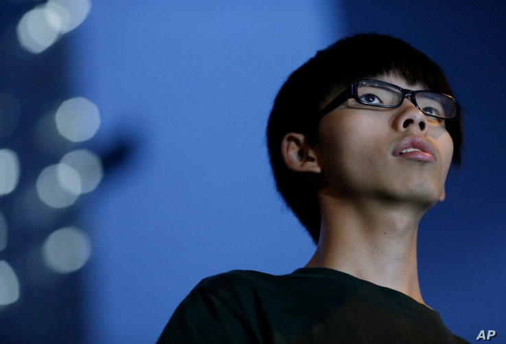 Joshua Wong, 17-year old student leader, stands on the stage during a rally in the occupied areas at Central district in Hong Kong, Oct. 9, 2014.