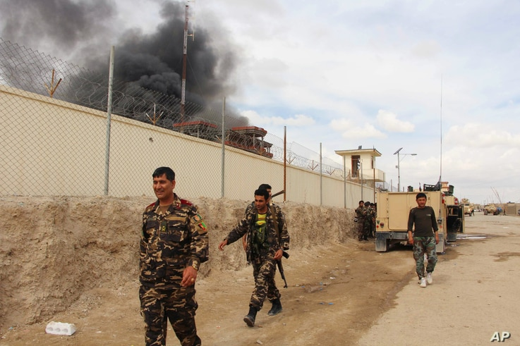 Smoke rises from a building where Taliban insurgents hid during a fight with Afghan security forces in Helmand province,  Afghanistan, March 9, 2016.
