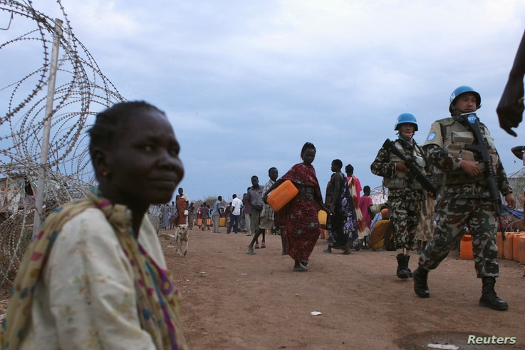 United Nations peacekeepers patrol in the camp for displaced people inside the United Nations Mission in South Sudan (UNMISS) compound in Malakal, Upper Nile State, which is currently held by anti-government forces, March 4, 2014. REUTERS/Andreea Cam...