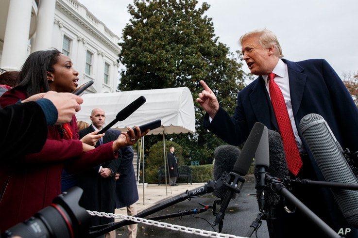 CNN journalist Abby Phillip asks President Donald Trump a question as he speaks with reporters before departing for France on the South Lawn of the White House, Nov. 9, 2018.