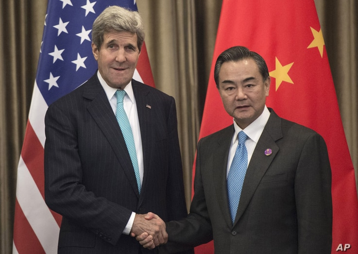 U.S. Secretary of State John Kerry, left,  and Chinese Foreign Minister Wang Yi meet on the sidelines of the Asia-Pacific Economic Cooperation (APEC) meeting in Beijing Friday, Nov. 7, 2014.