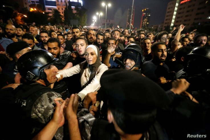 Demonstrators clash with riot police during a protest in Amman, Jordan, June 2, 2018.