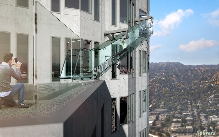 """An artist rendering of the """"Skyslide"""" attraction, an outdoor glass slide positioned close to 1,000 feet above downtown Los Angeles, California, is shown in this image released by OUE Skyspace, March 2, 2016."""