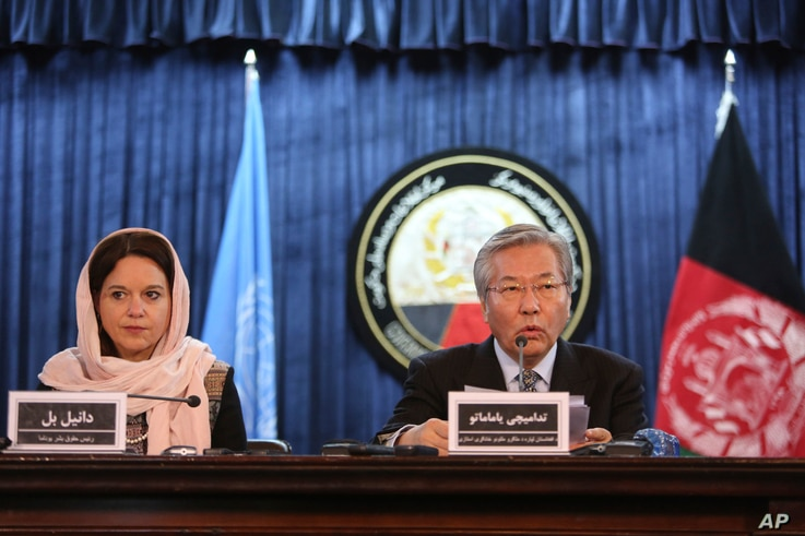 FILE - Tadamichi Yamamoto, United Nations Special Representative of the Secretary-General for Afghanistan, right, speaks during a press conference with Danielle Bell, United Nations Assistance Mission in Afghanistan, UNAMA, Human Rights Director, to ...
