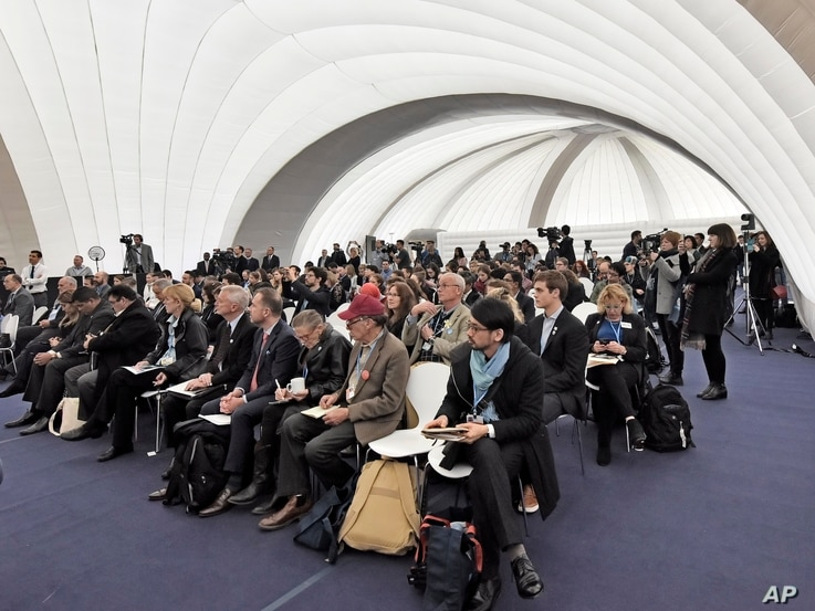 Visitors listen inside the U.S. Climate Action Center at the COP 23 Fiji U.N. Climate Change Conference in Bonn, Germany, Nov. 9, 2017.