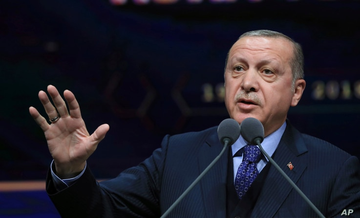 Turkey's President Recep Tayyip Erdogan speaks at a ceremony for judicial appointments in Ankara, March 19, 2018.
