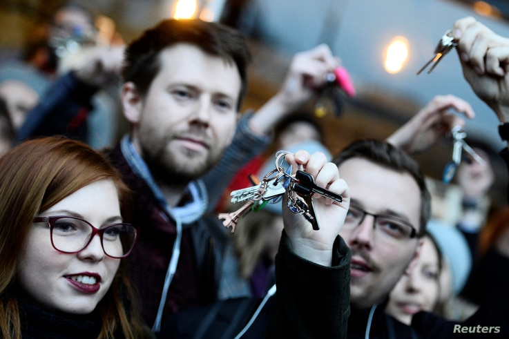 """Demonstrators rattle keys during a protest called """"Let's stand for decency in Slovakia"""" in reaction to the murder of Slovak investigative reporter Jan Kuciak and his fiancee, Martina Kusnirova, in Bratislava, Slovakia March 9, 2018."""