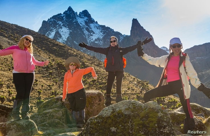 Nodumo Ncomanzi, Mariam Staford, Maah Koudia Keita and Jane Waithera pose for a photograph on Mount Kenya, May, 2018.