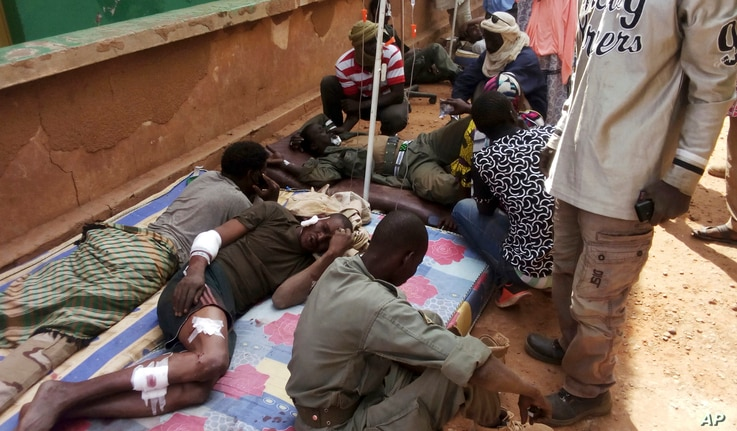 Wounded Malian troops receive medical treatment after being injured by an explosion at the Joint Operational Mechanism base in Gao, Mali, Jan. 18, 2017.