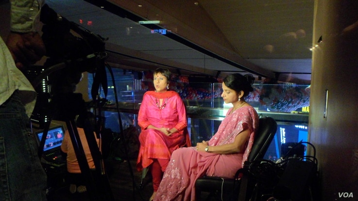 Barkha Dutt, (in red dress) Group Editor, NDTV. (Photo: Deepak Dobhal / VOA)