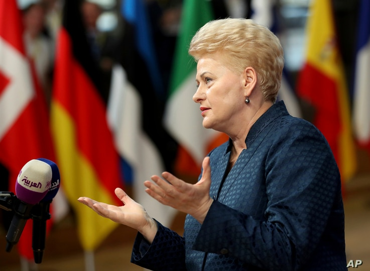 Lithuanian President Dalia Grybauskaite speaks with the media as she arrives for an EU summit in Brussels,  Oct. 17, 2018.