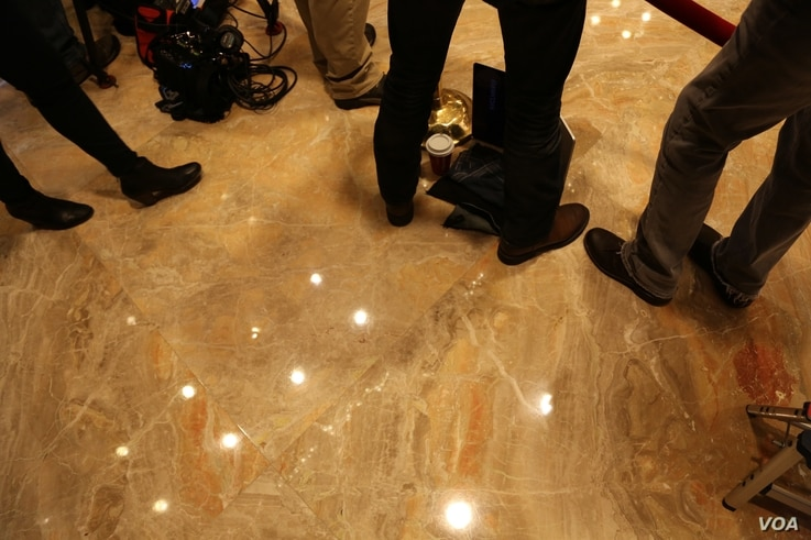 A day following the comings and goings at Trump Tower means more than eight hours on their feet for many journalists in New York, Dec. 12, 2016. (R. Taylor/VOA)