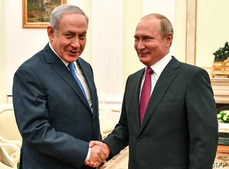 Russian President Vladimir Putin, right, shakes hands with Israeli Prime Minister Benjamin Netanyahu during their meeting at the Kremlin in Moscow, July 11, 2018.
