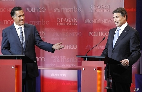 Former Massachusetts Governor Mitt Romney makes a point as Texas Governor Rick Perry (R) listens during the Reagan Centennial GOP presidential primary debate at the Ronald Reagan Presidential Library in Simi Valley, California September 7, 2011