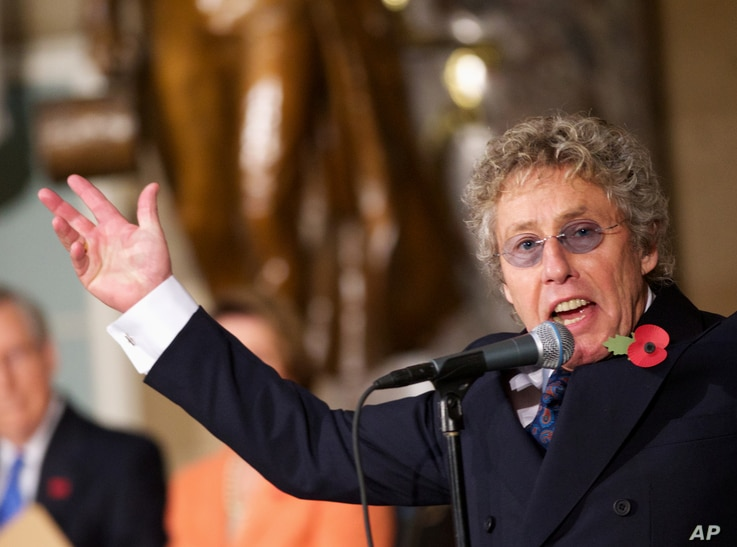The Who's Roger Daltrey performs in Statuary Hall on Capitol Hill in Washington during a ceremony to dedicate a bust of Winston Churchill, Oct. 30, 2013.