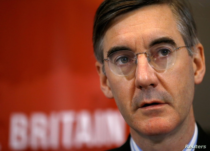 Conservative MP Jacob Rees-Mogg attends a meeting of the pro-Brexit European Research Group in London, , Nov. 20, 2018.