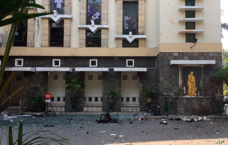 Debris is seen outside Santa Maria church, where an explosion went off in Surabaya, East Java, Indonesia, May 13, 2018. Media reports say simultaneous attacks on churches in Indonesia's second largest city of Surabaya have left casualties.