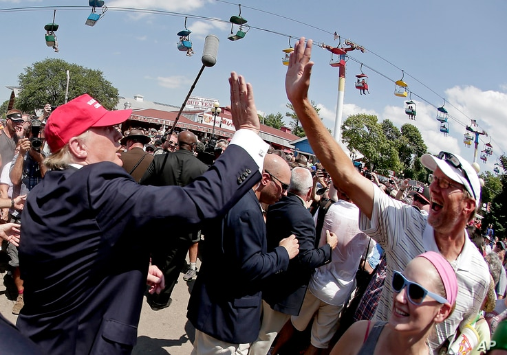 Republican presidential candidate Donald Trump greets the crowd at the Iowa State Fair in Des Moines, Aug. 15, 2015.