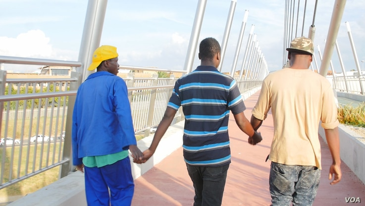The Mkhalipi brothers say they know xenophobia is not going away in South Africa, but they are willing to risk there lives for the economic opportunity that the country brings. VOA/ A. Powell)