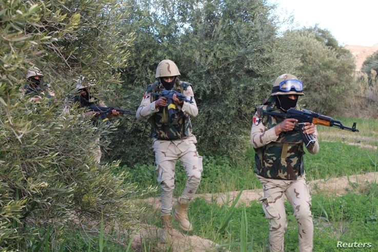 FILE - Egyptian Army officers are seen in the troubled northern part of the Sinai Peninsula during a launch of a major assault against militants, in Al Arish, Egypt, in this undated handout picture made available by the Ministry of Defense, March 4,