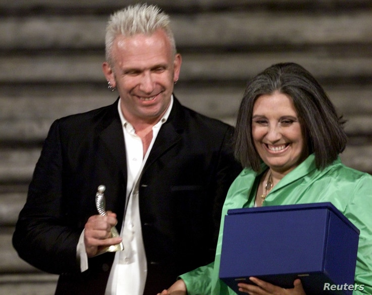 FILE - Fashion designers Jean Paul Gaultier and Laura Biagiotti during Rome's Spanish Steps fashion gala July 19, 2000.