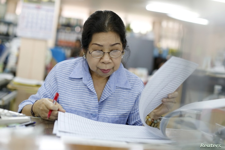 Sunisa Hongaroon, a 67-year-old accountant, works in a transportation company in Bangkok, Thailand, February 3, 2016.