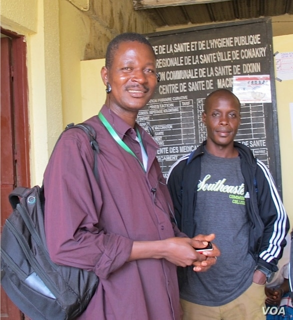 Community agents play a vital role in tracing Ebola contacts and monitoring their health. Here, two are shown at the Centre de Sante de Macire, a health center in Conakry, Guinea.