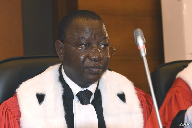 FILE - The president of the tribunal Gberdao Gustave Kam of Burkina Faso is seen in the courtroom during the first proceedings of the trial of Chadian dictator Hissene Habre, by the Extraordinary African Chambers in Dakar on July 20, 2015.