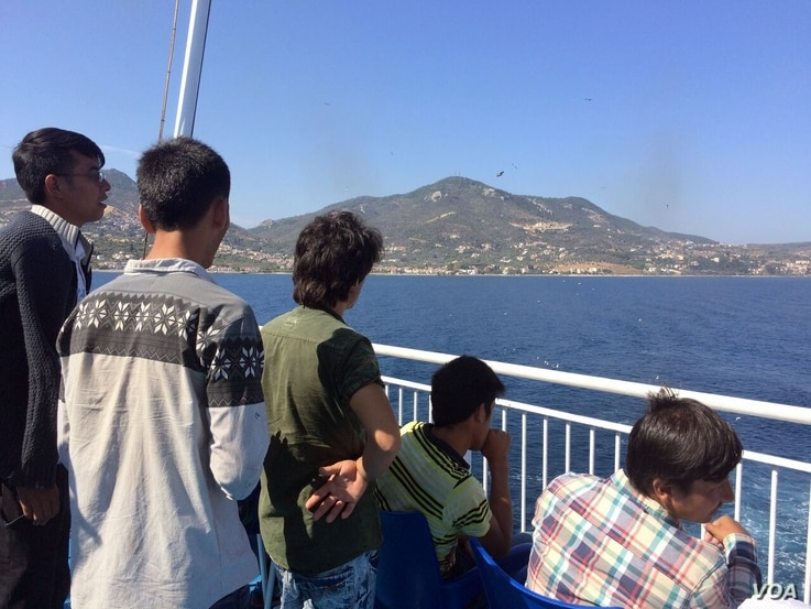 This commercial ship carries thousands of refugees and other migrants from the Greek islands they traveled to on rubber boats to Athens. Sept. 2015.  (Heather Murdock/VOA)