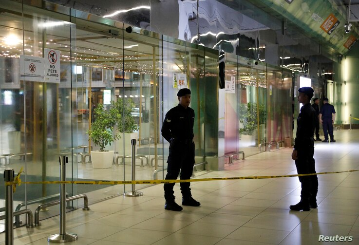 Police stand guard outside a partially closed KLIA2 airport terminal in Sepang, Malaysia, Feb. 26, 2017.