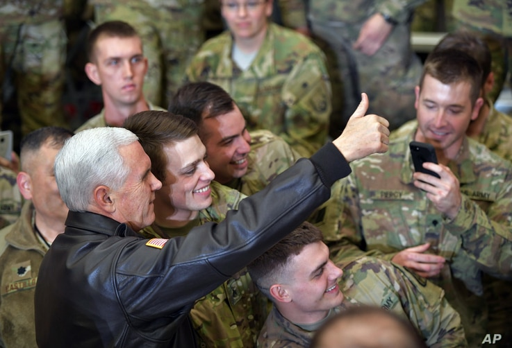 U.S. Vice President Mike Pence poses for photos with troops at Bagram Air Base in Afghanistan on Dec. 21, 2017.