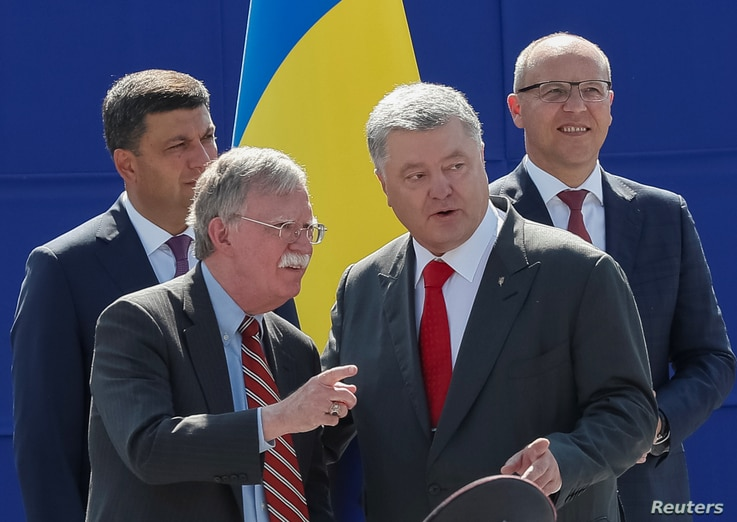 U.S. President Donald Trump's national security adviser John Bolton and Ukrainian President Petro Poroshenko attend a military parade marking Ukraine's Independence Day in Kyiv, Ukraine, Aug. 24, 2018.