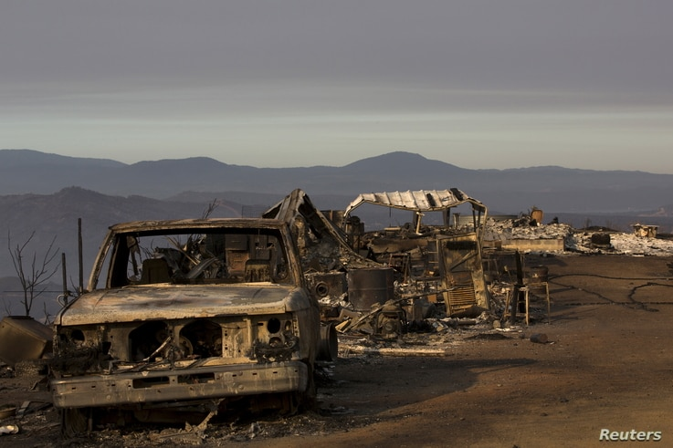 Properties destroyed by the Rocky Fire is seen near Clearake, California August 5, 2015. The blaze has charred some 68,300 acres, destroyed more than 50 buildings and displaced thousands of residents since erupting last week in the rugged canyons and...