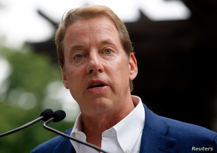FILE -  Executive Chairman of Ford Motor Co., Bill Ford Jr. addresses the public outside the Historic Ford Estate, once the home of his great-grandparents Henry and Clara Ford, during a celebration in honor of what would have been the 150th birthday ...