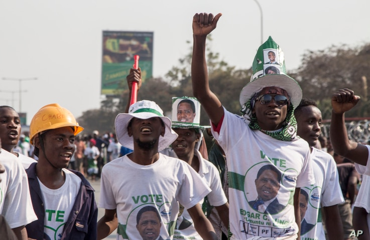 Supporters of the ruling party jubilate the results of the presidential elections in Lusaka, Zambia, Monday, Aug. 15, 2016. Zambia's president, Edgar Lungu, has been re-elected in a closely contested vote, but the opposition has alleged voting irregu