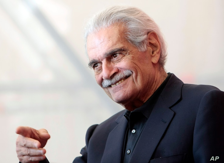 Egyptian actor Omar Sharif gestures during the photo call for the film 'Al Mosafer (The Traveller)' at the 66th edition of the Venice Film Festival in Venice, Italy, Sept. 10, 2009.